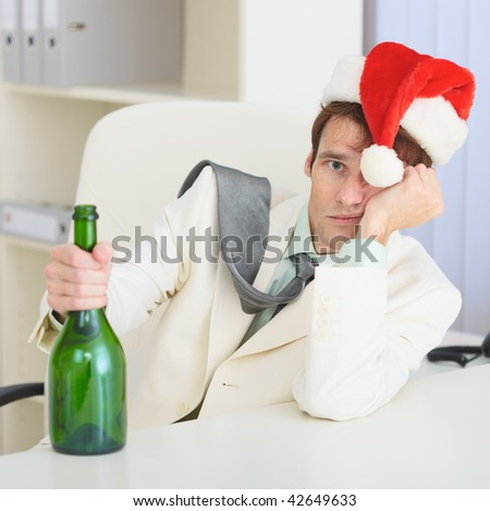 The young drunkard celebrates Christmas with a wine bottle - stock photo