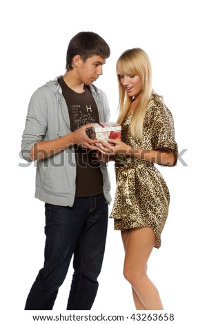 The young enamored man gives a gift to the girlfriend on a white background. - stock photo