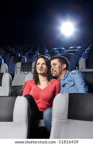 The young enamoured couple looks a film - stock photo