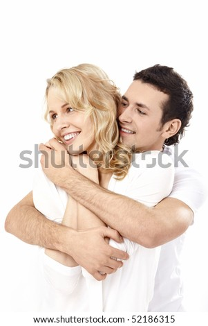 The young enamoured man embraces the girl on a white background - stock photo