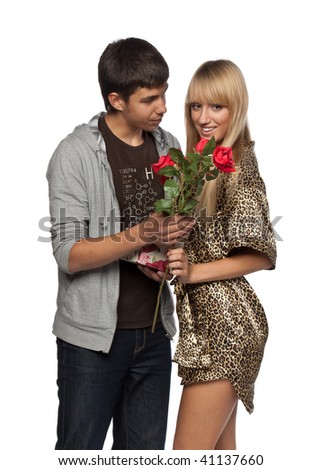 The young enamoured man gives a gift to the girlfriend on a white background. - stock photo