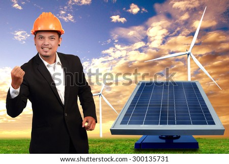The young engineer , wind turbines and solar cells. - stock photo