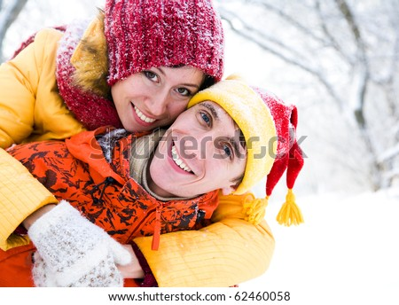 The young family plays winter wood on snow in Valentine's day