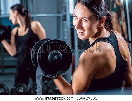 The young fitness woman and coach in the gym. Sport