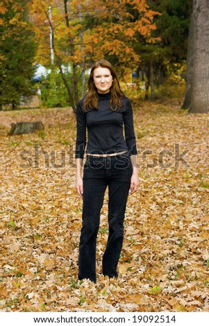 The young girl against autumn nature