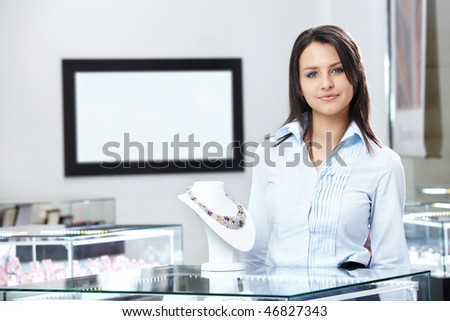 The young girl at show-windows of shop of jewels - stock photo