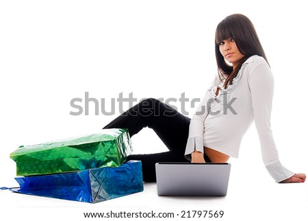 The young girl behind the computer after visiting of shops - stock photo