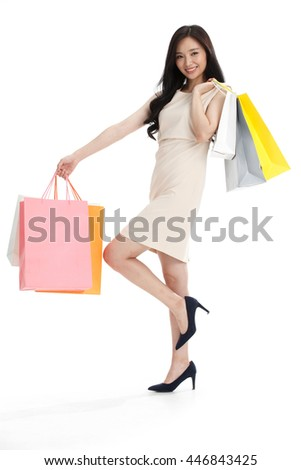 The young girl has a shopping bag. - stock photo