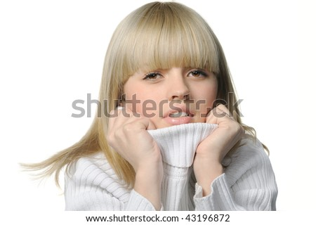 The young girl in a warm sweater. Feeling of a cold