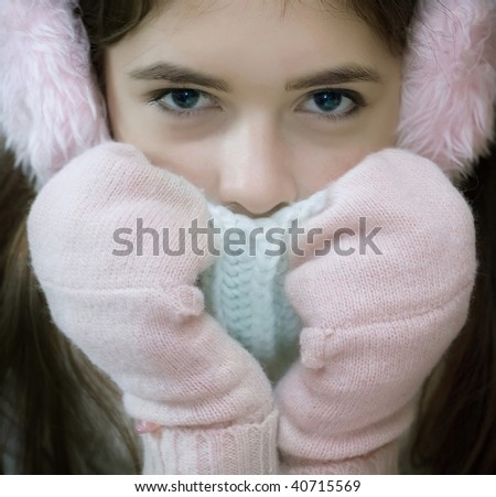 The young girl in mittens - stock photo