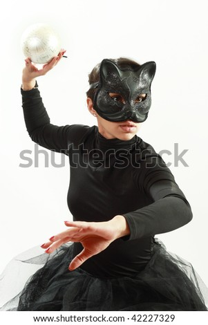 The young girl in the mask of a cat - stock photo