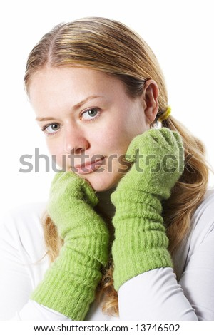 The young girl in warm gloves