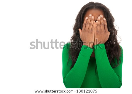 The young girl is covering the eyes with her hands - stock photo