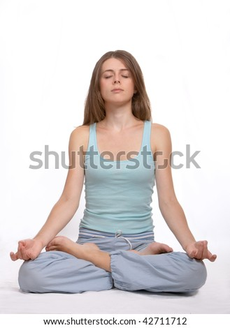 The young girl is engaged in yoga - stock photo