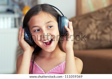 The young girl is singing the song - stock photo