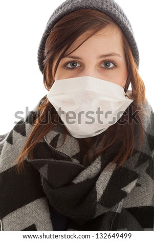 The young girl is wearing a surgical mask