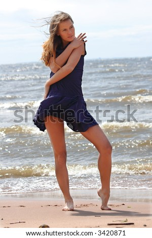 The young girl on a beach