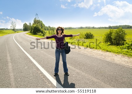 The young girl on automobile highway - stock photo