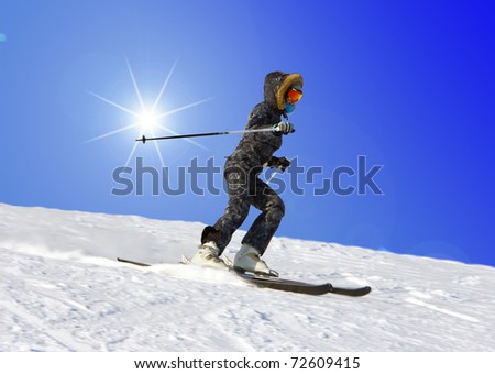The young girl on skis goes from mountain in a spotty suit - stock photo