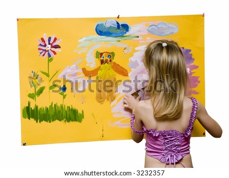 the young girl painting on a yellow background (The name of the picture - a bear in the spring:) - stock photo