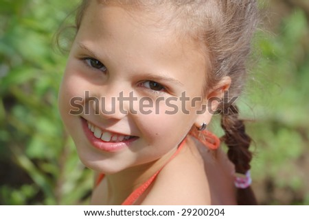 The young girl smiles - stock photo