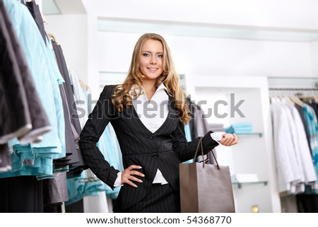 The young girl with a bag in clothes shop - stock photo