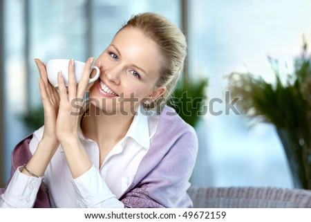 The young girl with a coffee cup in the foreground - stock photo