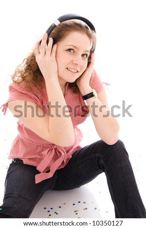 The young girl with a headphones isolated on a white background
