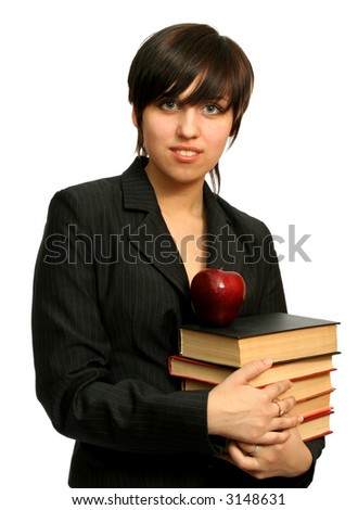 The young girl with books and a red apple, isolated on white - stock photo