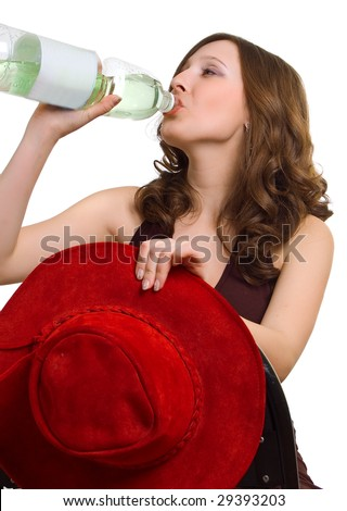 The young girl with red hat drinks water from a plastic bottle. Isolation on white - stock photo