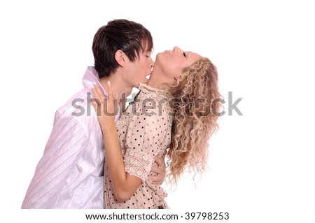 The young guy kisses the beautiful girl on a neck. It is isolated on a white background - stock photo