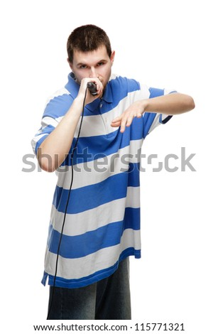 The young guy says into the microphone, isolated on white background.