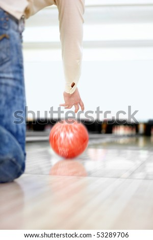 The young guy throws a sphere for bowling - stock photo