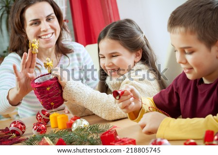 The young happy family is getting ready for the Christmas and Advent celebrations - stock photo