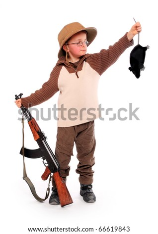 The young hunter dressed on a safari suit with rifle holding big rat. Funny image ready for your calendar. - stock photo