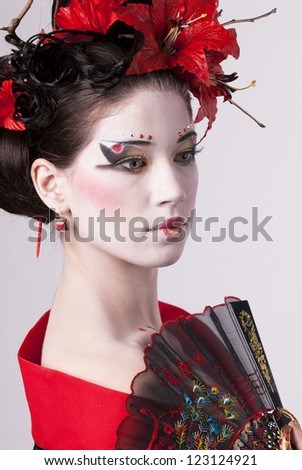 The young Japanese woman on a grey background - stock photo