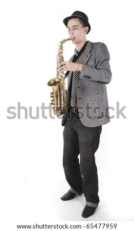 The young jazz man plays a saxophone - stock photo