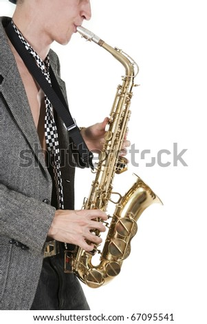 The young jazz man plays a saxophone