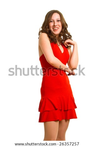 The young laughing women in red dress on a white background. Isolation - stock photo