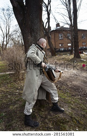 The young male leaned on the tree - stock photo