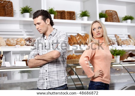 The young man and the girl have quarrelled in shop - stock photo