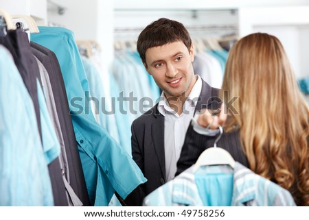 The young man and the girl in showroom - stock photo