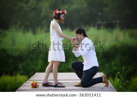 The Young man asks his girlfriend to marry with him - stock photo
