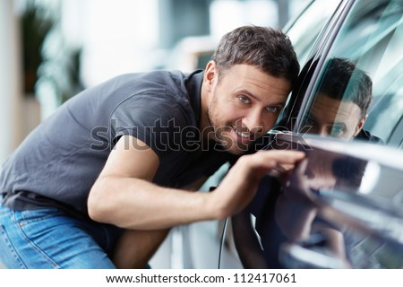 The young man at the machine - stock photo