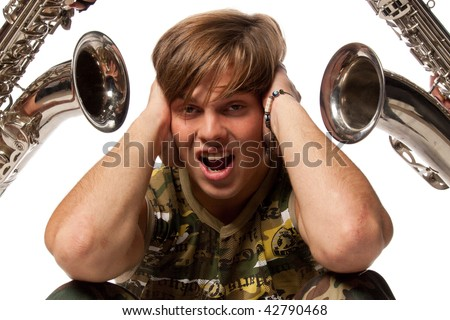 The young man closes ears hands from loud noise. - stock photo