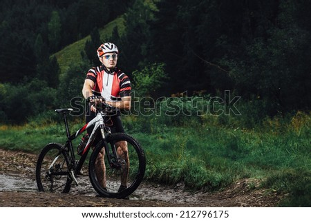 The young man cycling Cross-country - stock photo