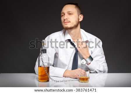 The young man feels suffocated by the habit to alcohol. Addicted to alcohol, alcoholism concept, social problem - stock photo