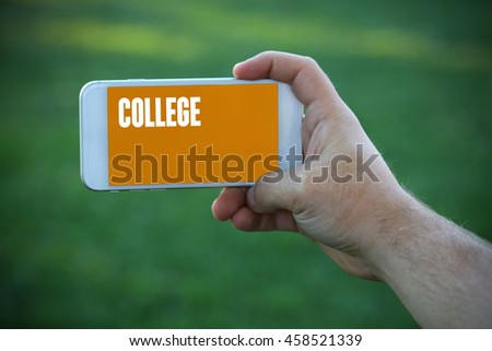 The young man holds the hand College by smartphone - stock photo