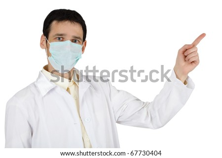 The young man in a medical mask points a finger - stock photo