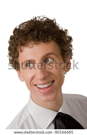 The young man in a white shirt cheerfully smiles - stock photo